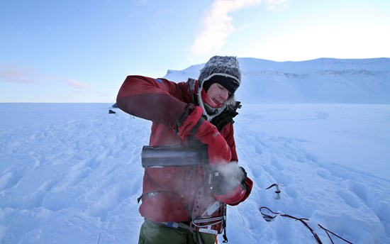 Erlend pouring himself a hot drink in the Arctic