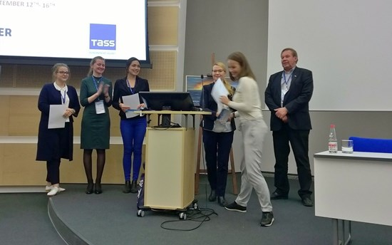 Maria Gostyaeva receiving her Student Award during the closing session of the UArctic Congress 2016. From the left: Student Ambassadors Anastasia Sokolova, Anastasia Chayka and Ulunnquaq Markussen, Research Coordinator Hannele Savela from the UArctic Thematic Networks and Research Liaison Office, and UArctic Vice-President Research Kari Laine.
