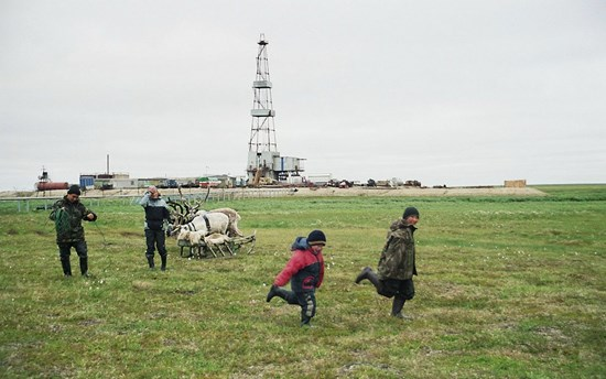 Stammler - Children from camp 2 playing on a pasture close to an oil rig on the Toravei deposit Nenets AO Barents Region Russia