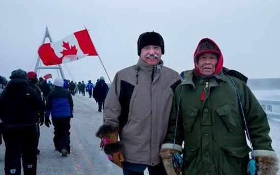 Dennis Bevington (MP, Western Arctic) with Elder Sam Elleze at the opening of the Deh Cho Bridge over the Mackenzie River near Fort Providence, Northwest Territories, Canada
