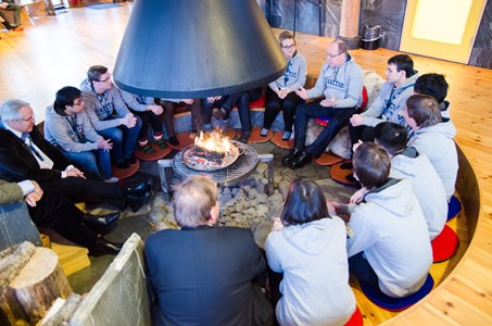 UArctic Student Ambassadors gather around fire with Prince Albert II of Monaco
